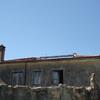Cobertura de um telhado com estrutura em madeira e telha de barro de 4 aguas 7mtx10mt