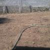 Colocação de terreno para preparação e colocação de tapete de relva/grama